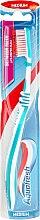 Profumi e cosmetici Spazzolino da denti, turchese - Aquafresh Between Teeth Medium