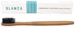 Profumi e cosmetici Spazzolino da denti al carbone di bambù - Glamza Activated Charcoal Infused Bamboo Toothbrush
