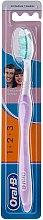Profumi e cosmetici Spazzolino da denti, viola - Oral-B 1 2 3 Delicat White 40 Medium