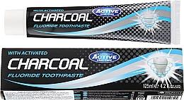 Profumi e cosmetici Dentifricio al carbone attivo - Beauty Formulas Charcoal Activated Fluoride Toothpaste